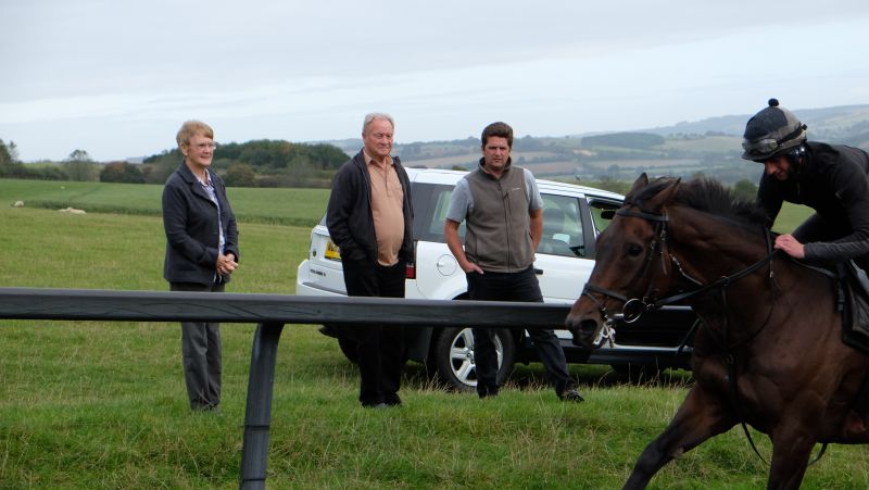 Pam and Derek with Mat watching the horses working
