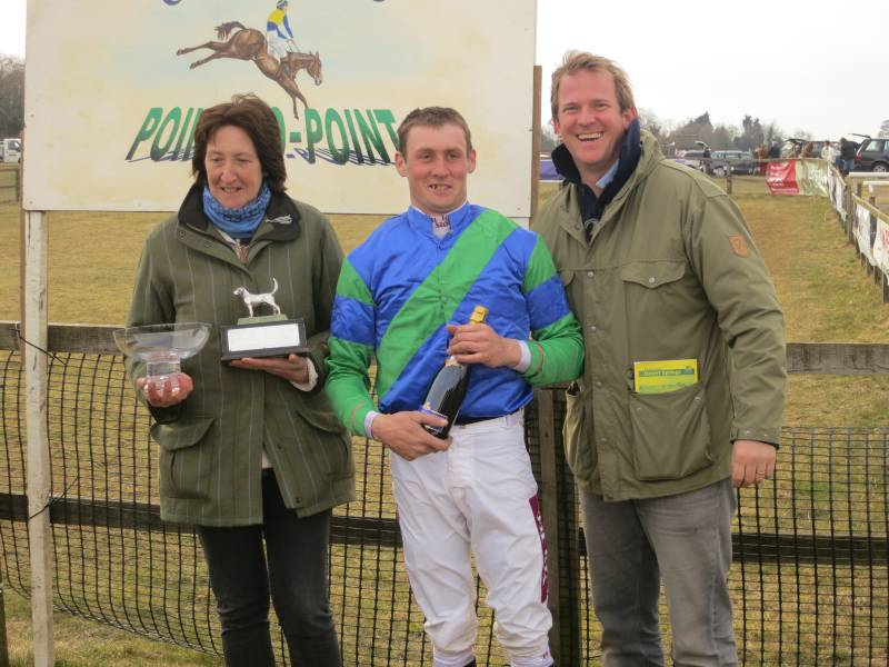 Sam giving his prize to jockey Jeremy Mahot