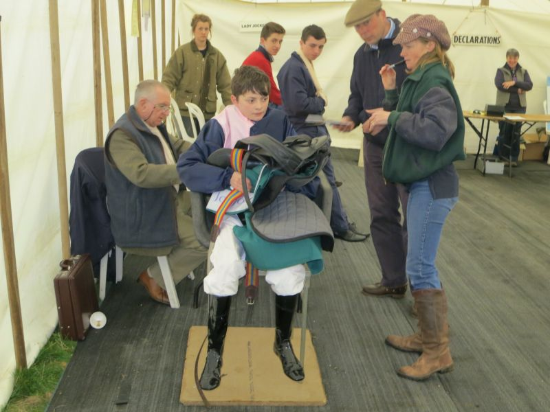 A pony rider weighing out watched by Louise Daly