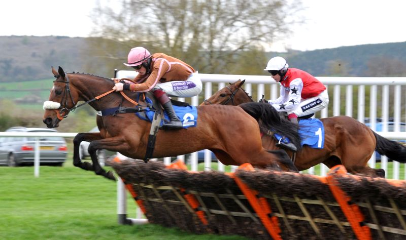 A winning ride at Ludlow. Sam Twiston-Davies jumping the last on Daivid Jenks's Magic Money.. Somewhere in behind is TNDGB's horse.