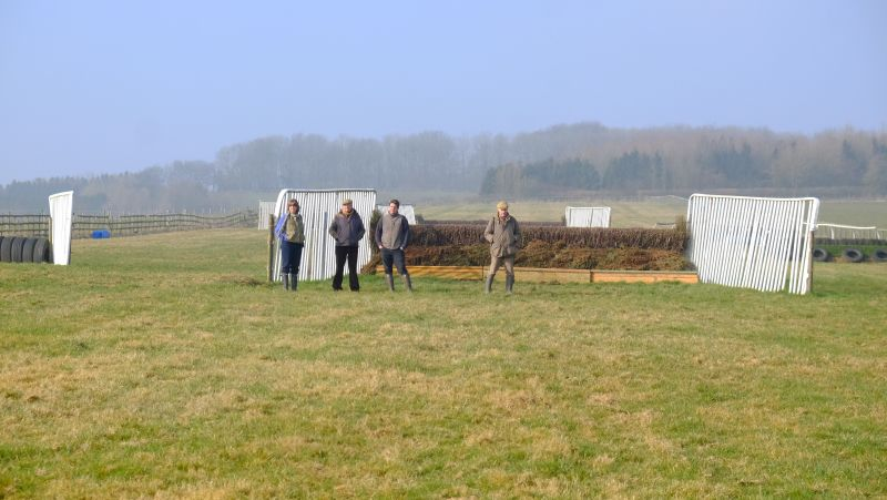 Liz and John Stanley with Mat and John Wills watching the schooling