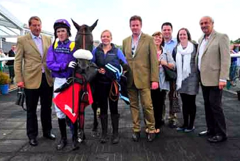 Dan Hall and his support team in the winners enclosure