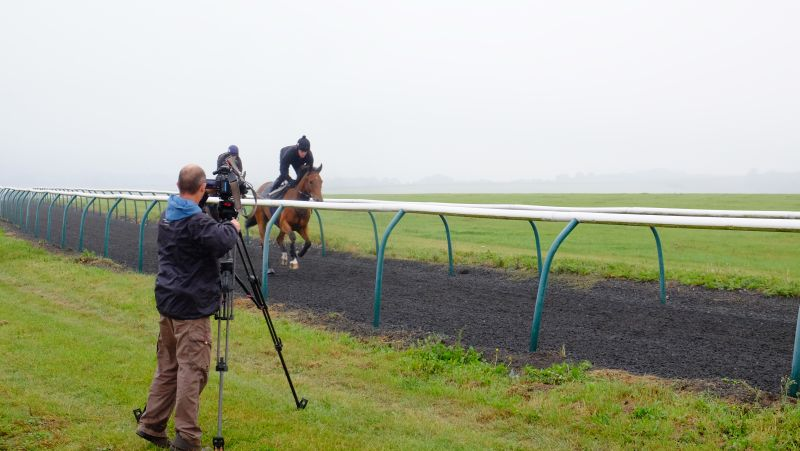 Luke Harvey filming the two horses cantering up Fishers Hill