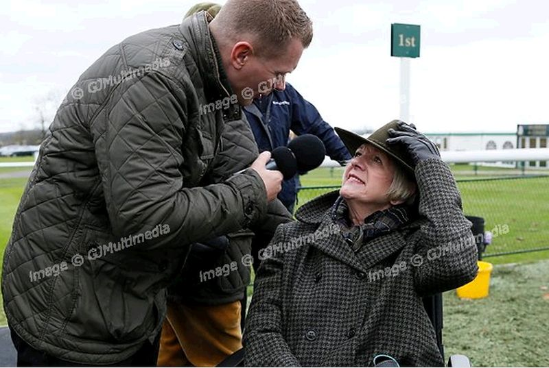 There is a downside to having a winner at Towcester... Matt Chapman with happy owner Penny Perriss