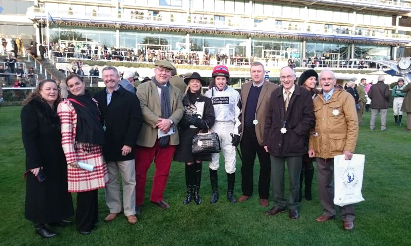 Jason Maguire with happy owners of Midnight Oscar soaking up the atmosphere of racing at Ascot