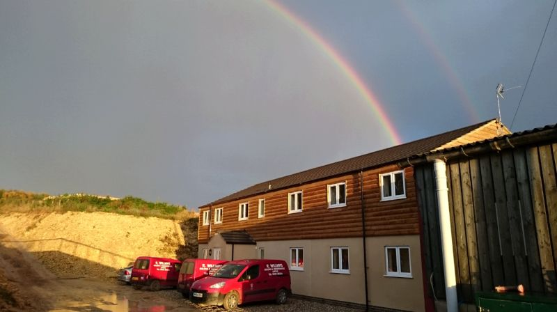 A rainbow over the new staff accomodation.. A pot of gold?. only in building costs so far!