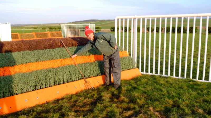 Will Riggall who is the head honcho in Lambourn in front of the new EasyFix fronted schooling fence