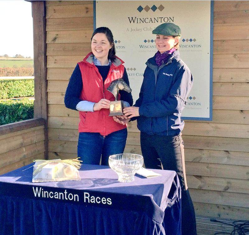 My travelling head girl Leigh Pollard rece=iving the winners trophy on behalf of Peter and Karin Swann