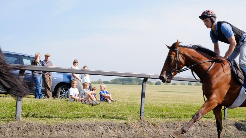 The Wills family watching the horses canter