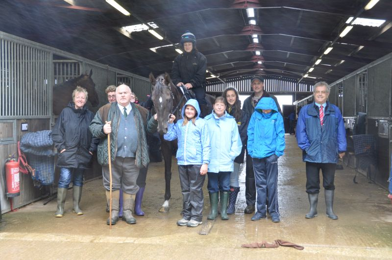 Robert Baskerville with family and friends and Midnight Oscar