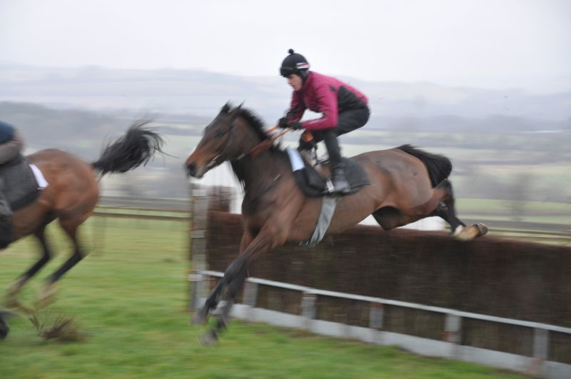 Not a good morning for my photos.. raining. Harry Topper flying the open ditch