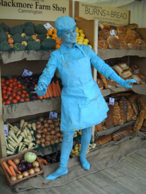 Turquoise Shopkeeper Living Statue